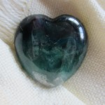 emerald heart on white cloth