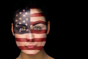 woman's face painted with American flag